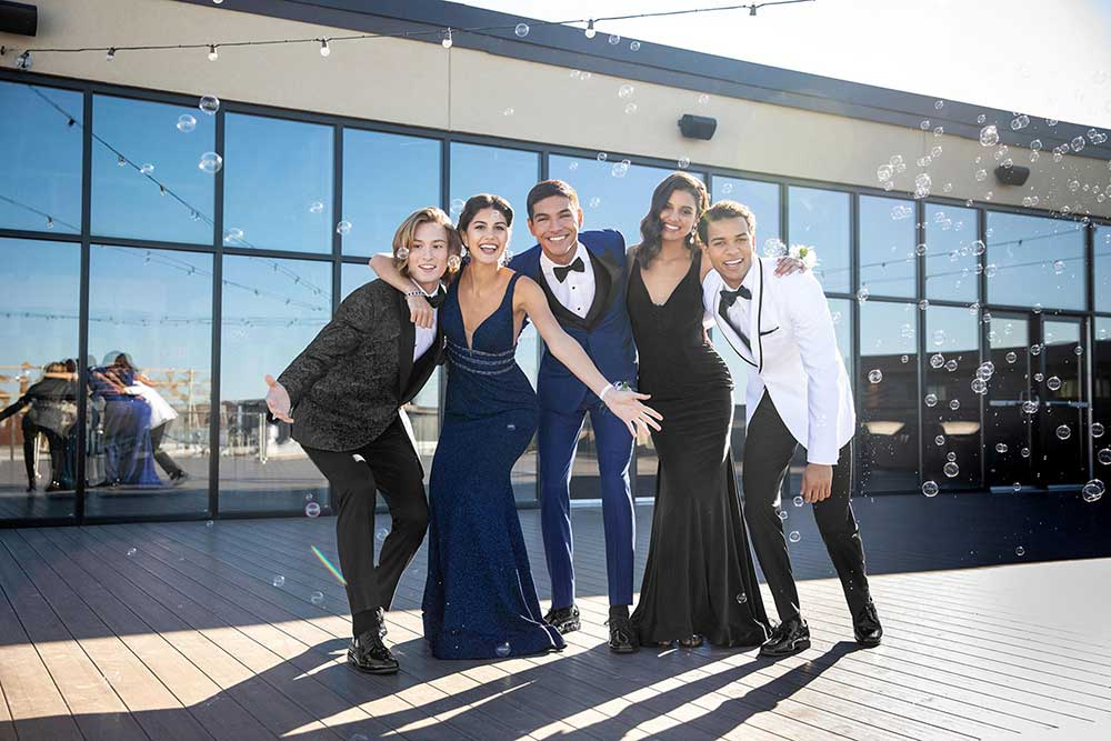 teens at prom in formal wear