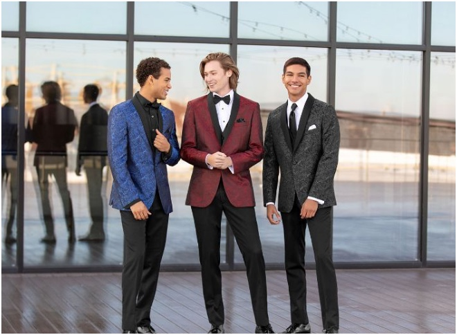 Teens dressed in suits at prom
