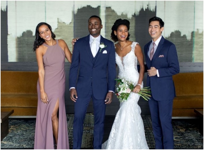 Wedding party dressed in suits and dresses