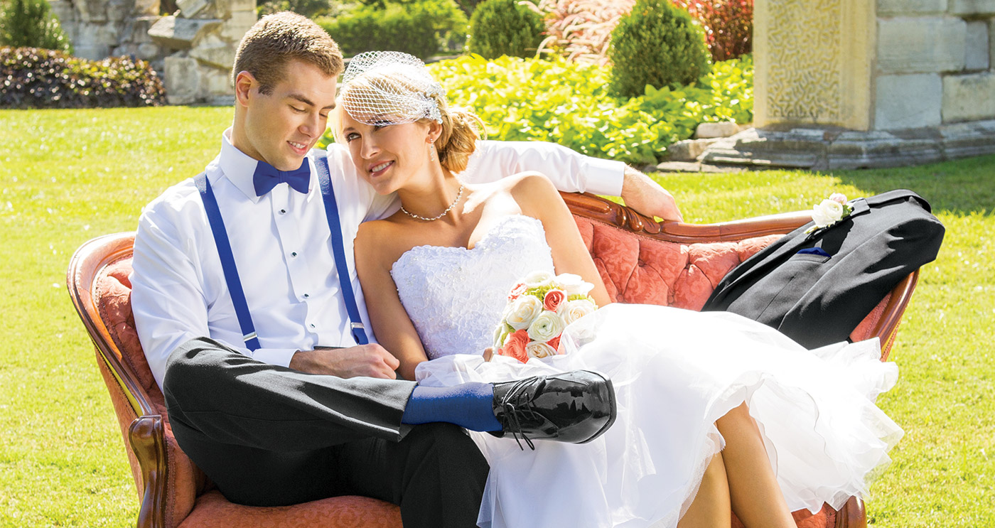 bride and groom relaxing outdoors