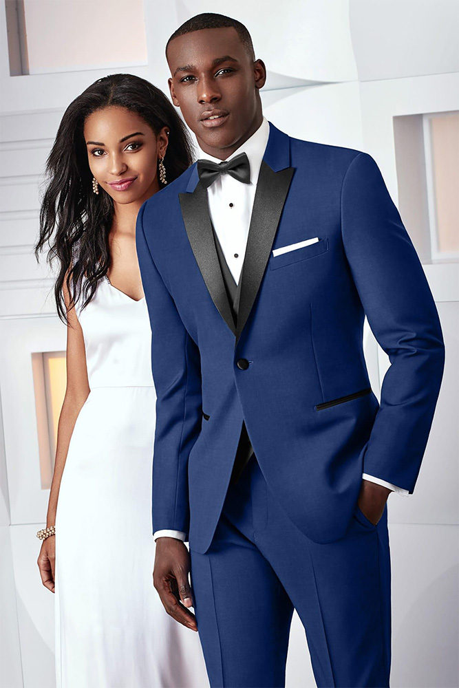Man in blue suit and woman in white dress